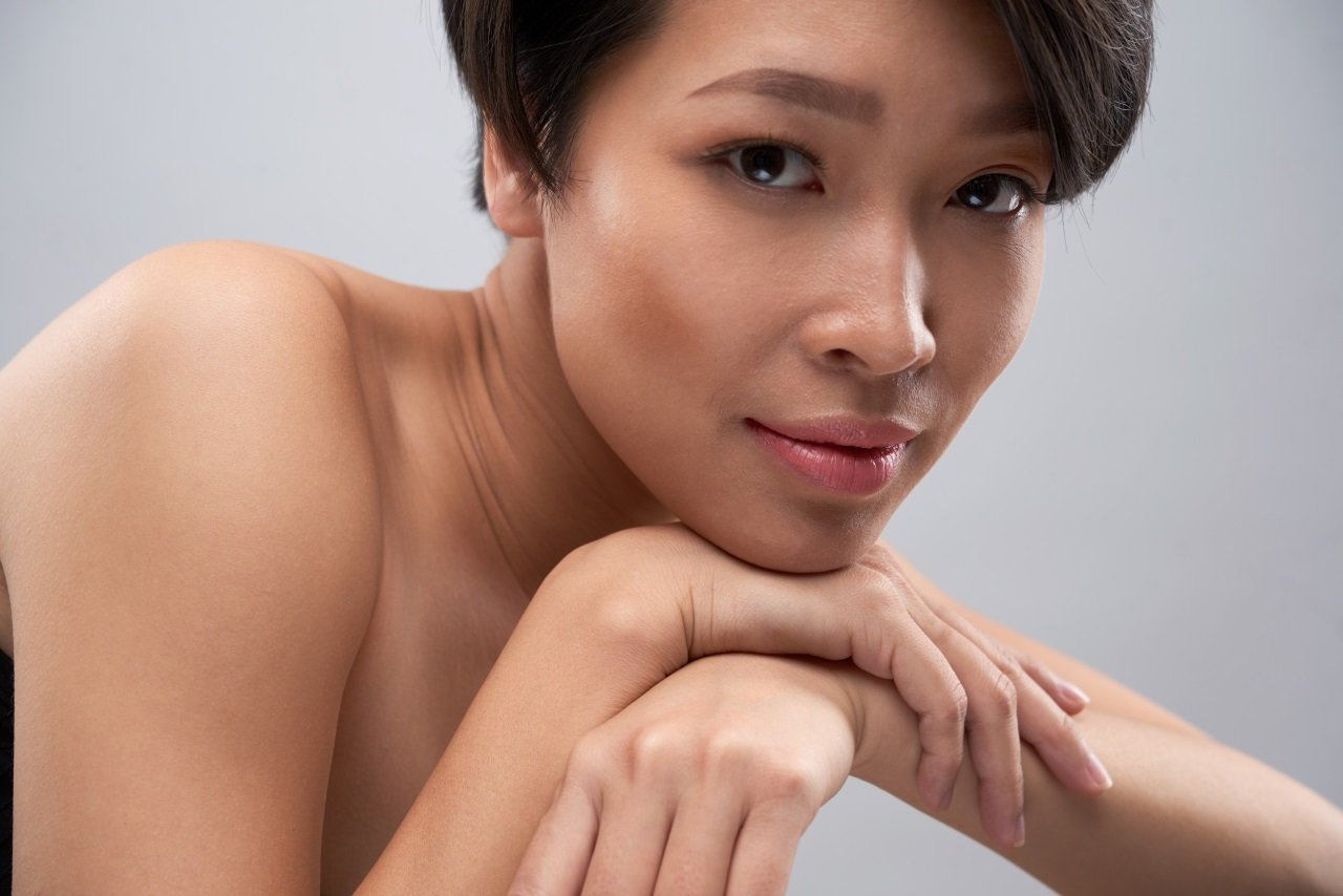 Female with flawless skin after acne treatment in singapore